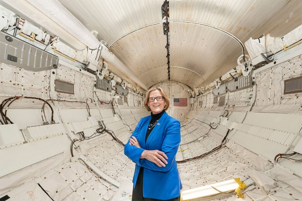 Dr. Kathryn Sullivan in the cargo bay that held the Hubble Space Telescope.